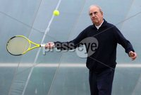 Northern Ireland- 21st March 2012 Mandatory Credit - Photo-Jonathan Porter/Presseye.  . During a brief visit back to the Province, keen tennis player, Senator George Mitchell officially opened the Belfast Boat Club 4 court dome.   A Democratic Senator in the Clinton administration George Mitchell played a leading role in peace negotiations here in Northern Ireland.  During this period he often played tennis at the Belfast Boat Club and with these fond memories he returned for a quick game together with his son Andrew.. Home to Northern Ireland's largest tennis club, the Belfast Boat Club            pioneered covered tennis when they erected the first three court dome in the country ten years ago.  That original membrane had to replaced this year so covering seven courts has been a considerable investment  of £200,000 for the club.. Boat Club Manager Doreen Brett commented, 'The Club hosts and competes in all the major tournaments, has a strong coaching academy and is gearing up to host the World Police and Fire games next year, so giving people the chance to play and train all year round is a necessity rather than a luxury.'. Photo:  Senator George Mitchell officially opens the 4 court dome at Belfast Boat.. END. Any queries, please contact Ann Gorman Marketing 07787563854.