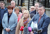 Press Eye - Belfast - Northern Ireland - 12th January 2018. Judge at Belfast High Court delays his ruling on a police ombudsman\'s report into the murders of six Catholic men in 1994 .  He said the ombudsman\'s new legal representative needed time to read himself into the case.  The men were shot dead by loyalist paramilitaries as they watched a World Cup football match in a pub in Loughinisland, County Down.  In June 2016, the police ombudsman ruled there had been collusion between some police officers and the gunmen.. Family members of those killed in the attack pictured outside the High Court in Belfast. . Picture by Jonathan Porter/PressEye
