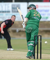 Mandatory Credit: Rowland White/Presseye. Cricket: Ulster Cup Round 1. Teams: North Down (green) v Limavady (back). Venue: The Green, Comber. Date: 2nd June 2012. Caption: This delivery from Andrew Riddles, Limavady, just missed the stumps. Alastair shields is the North Down batsman