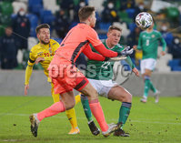 Press Eye - Belfast - Northern Ireland - 12th November 2020. UEFA Nations League 2021 - Northern Ireland Vs Romania at The National Stadium at Windsor Park, Belfast.. Northern Irelands goalkeeper Bailey Peacock-Farrell and Daniel Ballard with Romanias Alexandru Blu.. Picture by Jonathan Porter/PressEye