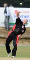 Mandatory Credit: Rowland White/Presseye. Cricket: Ulster Cup Round 1. Teams: North Down (green) v Limavady (back). Venue: The Green, Comber. Date: 2nd June 2012. Caption: Desmond Curry bowling for Limavady