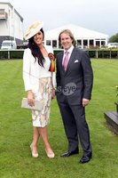 Press Eye - Belfast Northern Ireland - Saturday 23rd June 2012 - Press Release image. Summer Festival of Racing at Down Royal Racecourse - Magners Ulster Derby. Finalist of the Best Dressed competition, Fiona Sutton from Holywood with Down Royal Manager Mike Todd.. Picture by Kelvin Boyes / Press Eye.