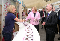 Press Eye - Belfast - Northern Ireland - 16th May 2019. Second day of the Balmoral Show, in partnership with Ulster Bank.  Pictured at Balmoral Park, outside Lisburn, are the Secretary of State for Northern Ireland Karen Bradley(centre) and Head of Ulster Bank Richard Donnan(right) who meet Anita McCann at her Rossi\'s Ice Cream business stall.  Ulster Bank has provided space in its market at Balmoral Show to entrepreneurs from Ulster Bank\'s Entrepreneur Accelerator programme as well as small business customers. . Picture by Jonathan Porter/PressEye