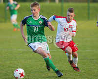 Press Eye Belfast - Northern Ireland 28th November 2017. School boys International - Northern Ireland Vs Poland at the Dub in south Belfast. . Northern Ireland\'s Ben Wylie with Poland\'s Michal Rakocry.. . Picture by Jonathan Porter/PressEye.com