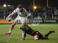 Guinness PRO14, Rodney Parade, Newport, Wales 1/12/2017. Dragons vs Ulster. Ulster\'s Stuart McCloskey is tackled by Dragons\' Dan Babos. Mandatory Credit ©INPHO/Bob Bradford
