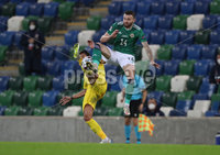 Press Eye-Belfast-Northern Ireland -18th November 2020. National Football Stadium at Windsor Park, Belfast. . 18/11/2020. Northern Ireland Stuart Dallas    and Romania  Camora   during Wednesday   night\'s UEFA Nations League match at the National Football Stadium at Windsor Park,Belfast.. Mandatory Credit PressEye