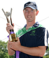 Mandatory Credit: Rowland White/Presseye. Cricket Ireland Press Conference to announce Squad for Austalian game at Stormont. Venue: Stormont. Date: 11th June 2012. Caption: Andrew White, Ireland with the RSA Trophy to be contested between Ireland and Australia at Stormont June 23
