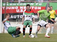 Press Eye - Belfast  - 11th August 2012. Danske Bank Premiership game between Glentoran and Donegal Celtic at The Oval, Belfast.. Glentorans Richard Clarke with John McGuigan and Donegal Celtics Conor Downey in action at Saturdays Danske Bank Premiership Game. . ©Russell Pritchard / Presseye