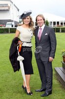 Press Eye - Belfast Northern Ireland - Saturday 23rd June 2012 - Press Release image. Summer Festival of Racing at Down Royal Racecourse - Magners Ulster Derby. Winner of the Best Dressed competition, Claudine Quinn from Newry with Down Royal Manager Mike Todd.. Picture by Kelvin Boyes / Press Eye.