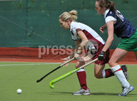 Mandatory Credit: Rowland White/Presseye. Women\'s Hockey: Irish Senior Cup Semi-Final. Teams: Queen\'s (blue) v Loreto (white). Venue: National Hockey Stadium, Dublin. Date: 12th May 2012. Caption: Joanne Orr, Queen\'s and Nicci Daly, Loreto