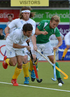 Mandatory Credit: Rowland White/Presseye. Men\'s Hockey: Senior Celtic Cup. Teams: Ireland (green) v South Africa (white). Venue: Lisnagarvey. Date: 27th June 2012. Caption: Thornton McDade and Jonathan Roberts SA with Michael Watt, Ireland