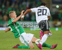 Press Eye - Belfast - Northern Ireland - 9th September 2019 . UEFA EURO Qualifier Group C at the National Stadium at Windsor Park, Belfast.  Northern Ireland Vs Germany. . Northern Ireland\'s George Saville with Germany\'s Serge Gnabry. Photo by Jonathan Porter / Press Eye.