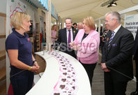 Press Eye - Belfast - Northern Ireland - 16th May 2019. Second day of the Balmoral Show, in partnership with Ulster Bank.  Pictured at Balmoral Park, outside Lisburn, are Ulster Bank\'s Dan McGinn(second from left) the Secretary of State for Northern Ireland Karen Bradley(centre) and Head of Ulster Bank Richard Donnan(right) who meet Anita McCann at her Rossi\'s Ice Cream business stall.  Ulster Bank has provided space in its market at Balmoral Show to entrepreneurs from Ulster Bank\'s Entrepreneur Accelerator programme as well as small business customers. . Picture by Jonathan Porter/PressEye