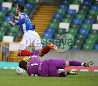PressEye-Northern Ireland- 18th April 2017-Picture by Brian Little/PressEye. Linfield Andrew Waterworth is brought down by Glenavon goal keeper  Jonathan Tuffey  during Easter Tuesday\'s Danske Bank Section A match at Windsor Park.. Picture by Brian Little/PressEye