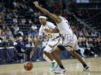 Press Eye - Belfast -  Northern Ireland - 01st December 2017 - Photo by William Cherry/Presseye. La Salle University\'s Amar Stukes with Towson College\'s Jordan McNeil during Friday evenings Basketball Hall of Fame Belfast Classic game at the SSE Arena, Belfast.