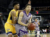 Press Eye - Belfast -  Northern Ireland - 02nd December 2017 - Photo by William Cherry/Presseye. La Salle University\'s Pookie Powell with College of the Holy Cross\'s Caleb Green during Saturday afternoons Basketball Hall of Fame Belfast Classic game at the SSE Arena, Belfast.  Photo by William Cherry/Presseye