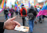 Press Eye - Belfast - Northern Ireland - 18th May 2019. Same sec marriage campaigners for Northern Ireland hold a march and rally in Belfast City Centre from Writers Square to the City Hall. The rally was addressed by the Sara Canning partner of Lyra McKee who was murdered after being shot dead by dissident republican in Derry last month.. A religious track is handed out at the parade. . Picture by Jonathan Porter/PressEye
