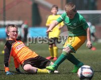 ©/Presseye.com - 9th July 2017.  Press Eye Ltd - Northern Ireland - Hughes Insurance Foyle Cup 2017- Mini Soccer U-10 - Clonmany Sdhamrocks (Donegal) V Aileach FC (Donegal). Aileach \'keeper Aaron Clarke-Doherty  denies Clonmanmy Shamrock\'s Mark McDaid..  . Mandatory Credit Photo Lorcan Doherty / Presseye.com
