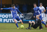 Danske Bank Premiership, Stangmore Park, Dungannon, Co. Tyrone 13/1/2018. Dungannon Swifts vs Coleraine. Dungannon\'s Paul McElroy works his way around referee Raymond Hetherington. Mandatory Credit ©INPHO/Matt Mackey