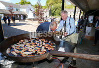 Press Eye - Belfast - Northern Ireland - 21st May 2019 - . The Prince of Wales and  Duchess of Cornwall are pictured meeting people from local businesses and members of the public from Lisnaskea, Co Fermanagh during their 2 day visit to Northern Ireland. . The Prince of Wales meets butcher Pat Doherty with his black bacon. . Photo by Jonathan Porter / Press Eye.