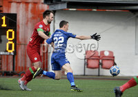 9th January 2021. Danske Bank Premiership, Solitude, Belfast . Cliftonville vs Crusaders. Cliftonville\'s Jamie Harney fouls   Crusaders Paul Heatley to give away a penalty . Mandatory Credit INPHO/Stephen Hamilton