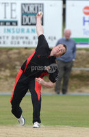 Mandatory Credit: Rowland White/Presseye. Cricket: Ulster Cup Round 1. Teams: North Down (green) v Limavady (back). Venue: The Green, Comber. Date: 2nd June 2012. Caption: Andrew Riddles bowling for Limavady