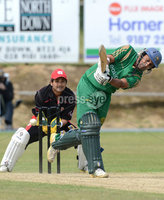 Mandatory Credit: Rowland White/Presseye. Cricket: Ulster Cup Round 1. Teams: North Down (green) v Limavady (back). Venue: The Green, Comber. Date: 2nd June 2012. Caption: North Down\'s Gayan Wijekwon