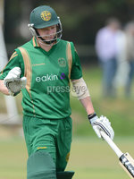 Mandatory Credit: Rowland White/Presseye. Cricket: Ulster Cup Round 1. Teams: North Down (green) v Limavady (back). Venue: The Green, Comber. Date: 2nd June 2012. Caption: Alastair Shields, North Down just failed to make his 50 - caught by Malik, bowled Desmond Curry for 48