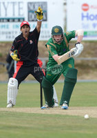Mandatory Credit: Rowland White/Presseye. Cricket: Ulster Cup Round 1. Teams: North Down (green) v Limavady (back). Venue: The Green, Comber. Date: 2nd June 2012. Caption: Limavady wicket-keeper, Zweshan Malik  and Alastair Shields, North Down
