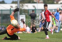 ©/Presseye.com - 9th July 2017.  Press Eye Ltd - Northern Ireland - Hughes Insurance Foyle Cup U-13 2017- GPS FC Bayern (USA) V Bertie Peacock Youth League.. Cooper Banks (GPS FC Bayern) scores against B Peacock YL \'keeper Dean Millar.. Mandatory Credit Photo Lorcan Doherty / Presseye.com