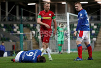 Press Eye - Belfast, Northern Ireland - 29th October 2019 - Photo by William Cherry/Presseye. Linfield\'s Joel Cooper after a challenge from Cliftonville\'s Liam Bagnall during Tuesday nights BetMcLean League Cup game at Windsor Park, Belfast.     Photo by William Cherry/Presseye