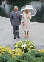 Press Eye - Belfast - Northern Ireland - 13th June 2018 - . The Prince of Wales has visited the Memorial Garden in Omagh Town Centre where a floral tribute was laid.   The wreath of white roses and herbs of remembrance (rosemary, lavender and thyme) was from the gardens of Hillsborough Castle.. His two-day visit to Northern Ireland began in Belfast earlier on Tuesday.. The Prince of Wales is pictured laying a wreath with the Duchess of Cornwall..  . Photo by Kelvin Boyes / Press Eye..