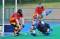 Mandatory Credit: Rowland White/Presseye. Men\'s Hockey: Irish Hockey League. Teams: Banbridge (red) v Instonians (yellow). Venue: Banbridge. Date: 14th April 2012. Caption: Banbridge goalkeeper fails to stop this shot from Mark Irwin, Instonians