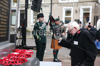 Wednesday 8th November 2017. . Picture by Press Eye.com. . Jim Dixon who was badly injured lays a wreath and tips his hat during the Service at the unveiling and dedication of the memorial for the victims of the 1987 Enniskillen Poppy Day Bomb.. ©presseye©