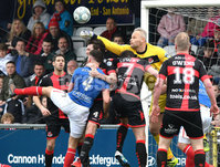 . Danske Bank Premiership Play-Off, Seaview, Belfast 14/4/2018 . Crusaders vs Linfield. Mandatory Credit ©INPHO/Stephen Hamilton. Crusaders Brian Jensen  with Linfields Josh Robinson