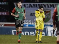 ©Russell Pritchard 20th December 2014 . Danske Bank Premiership game between Glentoran and Cliftonville at The Oval, Belfast.. Glentorans winning Goalscorer, Danny McKee celebrates as Cliftonvilles Tomas Cosgrove can\'t watchat Saturdays Game.. ©Russell Pritchard / Presseye