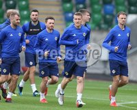 PressEye-Northern Ireland- 10th September  2018-Picture by Brian Little/ PressEye. Northern Ireland  Steven Davis leads the run during training ahead of Tuesday Friendly International Challenge match against Israel  at the National Football Stadium at Windsor Park.. Picture by Brian Little/PressEye .