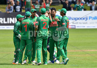 Mandatory Credit: Rowland White / PressEye. Cricket: Walton Tri-Series International. Teams: Ireland (light green) v Bangladesh (dark green). Venue: Malahide. Date: 19th May 2017. Caption: Bangladesh celebrate the wicket of Ireland\'s Gary Wilson