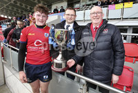 Press Eye Belfast - Northern Ireland 14th March 2019. Danske Bank U16High Schools Trophy Final. Craigavon High School(red) Vs Ballyclare Secondary School. . Craigavon lift the trophy after they win the final and are pictured with Ulster Rugby President Stephen Elliott(right) and Danske Bank Area Manager for Lisburn Chris Mitchell(centre). . Picture by Jonathan Porter/PressEye.com