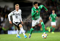 Press Eye - Belfast -  Northern Ireland - 09th September 2019 - Photo by William Cherry/Presseye . Northern Ireland\'s Jamal Lewis with Germany\'s Julian Brandt during Monday nights European Championship Qualifier at the National Stadium at Windsor Park, Belfast.  Photo by William Cherry/Presseye