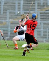 Ulster GAA Minor Hurling Championship Semi Final - Armagh V Down - 1 July 2012. Copyright Presseye.com. Mandatory Credit Declan Roughan / Presseye. Downs\'s Conal Fitzsimmons has a shot at Armagh\'s Ryan Lundy