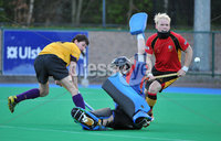 Mandatory Credit: Rowland White/Presseye. Men\'s Hockey: Irish Hockey League. Teams: Banbridge (red) v Instonians (yellow). Venue: Banbridge. Date: 14th April 2012. Caption: Goalkeeper Gareth Lennox and Philip Brown save the day for Banbridge as John Watson attacks for Instonians
