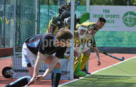 Mandatory Credit: Rowland White/Presseye. Men\'s Hockey: Irish Senior Cup Semi-Final. Teams: Lisnagarvey (blue) v Railway Union (yellow)). Venue: National Hockey Stadium, Dublin. Date: 12th May 2012. Caption: Railway Union defend