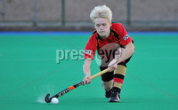 Mandatory Credit: Rowland White/Presseye. Men\'s Hockey: Irish Hockey League. Teams: Banbridge (red) v Instonians (yellow). Venue: Banbridge. Date: 14th April 2012. Caption: Peter Brown, Banbridge