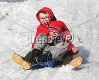 ©Lorcan Doherty February 12th 2018. . Brothers Alex (9) and Con (6) Nelis, from Creggan,  enjoying the Mid Term Break snow fall in Brooke Park.