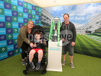 Press Eye - Belfast - Northern Ireland - 16th May 2018. First day of the 2018 Balmoral Show, in partnership with Ulster Bank, at Balmoral Park.  Ulster Bank has the NatWest Six Nations trophy at its stand over the four days of this year's Balmoral Show. Visitors to the show today had the chance to have their photo taken with the trophy which Ireland claimed this year as part of their Grand Slam success. Pictured with the trophy are the Parkinson family from east Belfast. . Picture by Jonathan Porter/PressEye