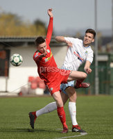 13th April 2019. Danske Bank Irish premiership. Cliftonville v Ballymena United at Solitude Belfast.. Cliftonville\'s Ryan Curran  in action with Ballymena\'s .  Adam Leckey. Mandatory Credit -Inpho/Stephen Hamilton .