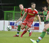 4th August 2018. Danske Bank Irish premier league match between Glentoran and Cliftonville at The Oval in Belfast.. Glentorans Dylan Davidson  in action with Cliftonvilles Jay Donnelly.  Mandatory Credit: Stephen Hamilton /Inpho