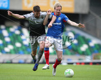Danske Bank Premiership, Windsor Park, Belfast 10/8/2019. Linfield vs Institute. Linfield\'s Ryan McGivern with Institute\'s Niall Grace. Mandatory Credit INPHO/John McVitty