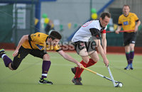 Mandatory Credit: Rowland White/Presseye. Men\'s Hockey: Irish Senior Cup Semi-Final. Teams: Cork Harlequins (black) v Instonians (yellow). Venue: National Hockey Stadium, Dublin. Date: 12th May 2012. Caption: Mark Black, Cork and James Corry, Instonians